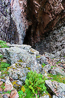 Norway, Trondelag. Harbakshola in Stokksund is a 130m deep natural cave, approx. 40m high.