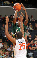 Dec. 20, 2010; Charlottesville, VA, USA; Norfolk State Spartans guard/forward Chris McEachin (35) shoots over Virginia Cavaliers forward Akil Mitchell (25) during the game at the John Paul Jones Arena. Mandatory Credit: Andrew Shurtleff