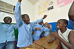 Refugee boys celebrate winning an in class competition in a school operated by St. Andrew's Refugee Services in Cairo, Egypt. Located at St. Andrews United Church of Cairo, the program is supported by Church World Service.