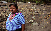 Magdalena, a Mayan woman, stands where her home is buried in mud. Mudslides destroyed the town earlier in the month when Hurricane Stan spawned torrential rains over parts of Central America. Hundreds of people and houses were buried in the mudslide that caught the town by surprise in the early morning hours.<br />