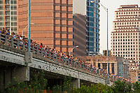 Every summer night, hundreds of people gather to see the world's largest urban bat colony emerge from under the Congress Avenue Bridge in downtown Austin, Texas.