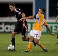 Branko Boskovic (27) of DC United takes the ball away from Brian Ching (25) of the Houston Dynamo during their game at RFK Stadium in Washington, DC.  Houston defeated D.C. United, 3-1.