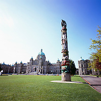 "Victoria, BC, Vancouver Island, British Columbia, Canada - BC Parliament Buildings and ""Knowledge Totem"" (Coast Salish carver Cicero August - 1990 - Loon on Top, Fisherman below, then Bone Game Player, and Frog on Bottom)"
