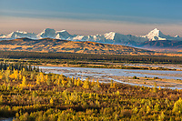 Prominent peaks in the Alaska range mountains, Moffit, Hayes, (left to right) Tanana river in the foreground, interior, Alaska.
