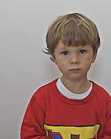Young boy in red shirt