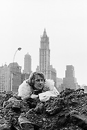 December 1969, Manhattan, New York City, New York State, USA --- French actor Yves Renier looks over the top of a pile of dirt and rocks near New York's Financial District. --- Image by © JP Laffont