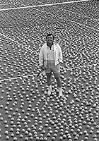 Vic Braden stands amid a sea of tennis balls. Vic Braden Tennis College, Coto de Caza, CA, 1975. Photo by John G. Zimmerman