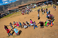 Peruvian peasants dance in the bullring before the Yawar Fiesta, a ritual fight between the condor and the bull, held in the mountains of Apurímac, Cotabambas, Peru, 30 July 2012. The Yawar Fiesta (Feast of Blood), an indigenous tradition which dates back to the time of the conquest, consists basically of an extraordinary bullfight in which three protagonists take part - a wild condor, a wild bull and brave young men of the neighboring communities. The captured condor, a sacred bird venerated by the Indians, is tied in the back of the bull which is carefully selected for its strength and pugnacity. A condor symbolizes the native inhabitants of the Andes, while a bull symbolically represents the Spanish invaders. Young boys, chasing the fighting animals, wish to show their courage in front of the community. However, the Indians usually do not allow the animals to fight for a long time because death or harm of the condor is interpreted as a sign of misfortune to the community.