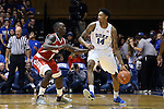 30 October 2015: Duke's Brandon Ingram (14) and Florida Southern's Dominique Williams (12) The Duke University Blue Devils hosted the Florida Southern College Moccasins at Cameron Indoor Stadium in Durham, North Carolina in a 2015-16 NCAA Men's Basketball Exhibition game. Duke won the game 112-68.