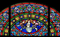 The soul of Saint Louis being carried to heaven by 2 angels, above the medallion of the death of Saint Louis in Tunis during the 8th Crusade, stained glass window, 1871, in the apse of the Collegiale Notre-Dame de Poissy, a catholic parish church founded c. 1016 by Robert the Pious and rebuilt 1130-60 in late Romanesque and early Gothic styles, in Poissy, Yvelines, France. The windows of the apse tell the story of Saint Louis or King Louis IX of France, born in Poissy in 1214. The Collegiate Church of Our Lady of Poissy was listed as a Historic Monument in 1840. Picture by Manuel Cohen