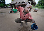 "Mission Dzongololo, 10, washes his face as he prepares to go to school in the morning in Chidyamanga, a village in southern Malawi that has been hard hit by drought in recent years, leading to chronic food insecurity, especially during the ""hunger season,"" when farmers are waiting for the harvest."