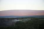 Steam vents along the edge of the Kilauea Crater as viewed at dawn from the Volcano House located in the Hawaii Volcanoes National Park
