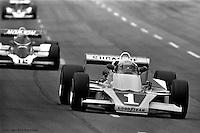HAMPTON, GA - APRIL 22: Tom Sneva (#1 McLaren M24/Cosworth TC) drives ahead of Bobby Unser (#12 Penske/Cosworth TC) and Rick Mears (#9 Penske/Cosworth TC) during the Gould Twin Dixie 125 event on April 22, 1979, at Atlanta International Raceway near Hampton, Georgia.