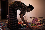 27 year old Maskuri spends time with his wife, Warniti (26) and their 10 months son, Yusril Kurniawal in her household chores in his house in Suradadi VIllage in Tegal of Central Java region in Indonesia. Photo: Sanjit Das/Panos