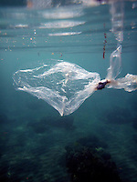 A plastic bag floats by a beach in Pemuteran on Bali's North coast. The beaches are full of plastic and other rubbish washed up from the ocean, especially in the rainy season.