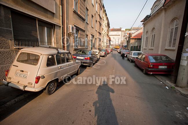Parked cars on narrow Nishka Street, Belgrade, Serbia.
