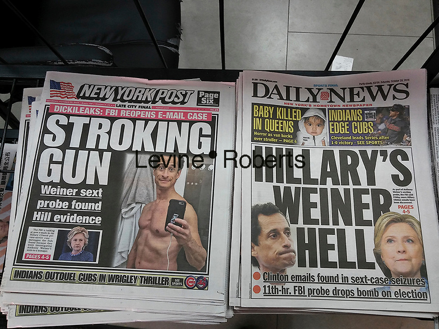 Headlines of the New York tabloid newspapers on Saturday, October 29, 2016 report on the FBI investigation of a computer used by Anthony Weiner and Huma Abedin in relation to Hillary Clinton emails.. (© Richard B. Levine)