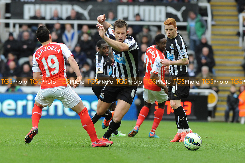 Michael Williamson of Newcastle United takes on Santi Cazorla of Arsenal - Newcastle United vs Arsenal - Barclays Premier League Football at St James Park, Newcastle upon Tyne - 21/03/15 - MANDATORY CREDIT: Steven White/TGSPHOTO - Self billing applies where appropriate - contact@tgsphoto.co.uk - NO UNPAID USE