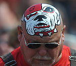A Georgia fan has a Bulldog painted on his head at Vaught-Hemingway Stadium in Oxford, Miss. on Saturday, September 24, 2011. Georgia won 27-13.