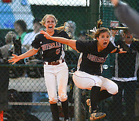 Gary Cosby Jr./Decatur Daily     Hartselle players celebrate their 5A State Championship after defeating Moody on a two run, walk off home run by Hartselle's Hannah Jenkins.  Sarah Ellen Battles and Madeline Sittason leap and shout for joy as Jenkins circles the bases.