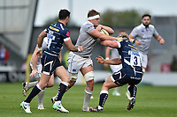 Tom Ellis of Bath Rugby fends Ross Harrison of Sale Sharks. Aviva Premiership match, between Sale Sharks and Bath Rugby on May 6, 2017 at the AJ Bell Stadium in Manchester, England. Photo by: Patrick Khachfe / Onside Images