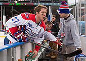 Zack Kamrass (UML - 27), Ryan McGrath (UML - 10), Ryan Ward (UML - Manager) - The Northeastern University Huskies defeated the University of Massachusetts Lowell River Hawks 4-1 (EN) on Saturday, January 11, 2014, at Fenway Park in Boston, Massachusetts.