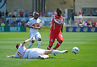 New York defender Jan Gunnar Solli (8) slide tackles the ball away from Chicago midfielder Patrick Nyarko (14).  The Chicago Fire tied the New York Red Bulls 1-1 at Toyota Park in Bridgeview, IL on June 26, 2011.
