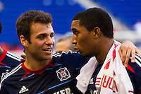 Michael Videira (21) (L) of the Chicago Fire celebrates with Sherjill MacDonald (7) ® after the match. The Chicago Fire defeated the New York Red Bulls 2-0 during a Major League Soccer (MLS) match at Red Bull Arena in Harrison, NJ, on October 06, 2012.