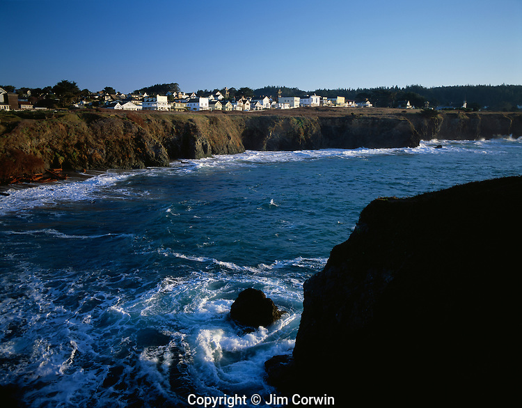 Downtown historic buildings along bluff with shops at sunrise along bluff Mendocino California USA