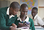 Girls consult about their studies in a class at the Loreto Secondary School in Rumbek, South Sudan. The school is run by the Institute for the Blessed Virgin Mary--the Loreto Sisters--of Ireland.