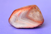 Agate is a micro crystalline variety of silica, chiefly chalcedony, characterized by its fineness of grain and brightness of color. This particular agate came from the shores of Lake Superior in Michigan. Specimen Dimension: approximately 4 cm.