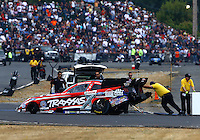 Aug. 3, 2013; Kent, WA, USA: Members of the safety safari push NHRA funny car driver Courtney Force off the track during qualifying for the Northwest Nationals at Pacific Raceways. Mandatory Credit: Mark J. Rebilas-USA TODAY Sports