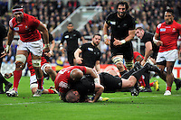 Tony Woodcock of New Zealand scores a try in the first half. Rugby World Cup Pool C match between New Zealand and Tonga on October 9, 2015 at St James' Park in Newcastle, England. Photo by: Patrick Khachfe / Onside Images