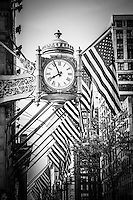 Chicago Macy's clock in black and white. The Macy's clock (Marshall Field's) in downtown Chicago is a famous Chicago icon.
