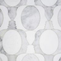 Janus, a waterjet mosaic shown in polished Carrara and Thassos, is part of the Illusions™ Collection by Sara Baldwin Designs for New Ravenna.