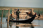 Marsh Arabs. Southern Iraq. Circa 1985. Marsh Arab soldiers in boats after destruction of village during / after Iran Iraq border dispute war.