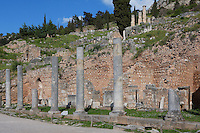 DELPHI, GREECE - APRIL 12 : A general view of the northern portico of the Roman Agora with a line of shops in the background and the Temple of Apollon in the distance, on April 12, 2007 in the Sanctuary of Apollo, Delphi, Greece. The Roman Agora was built in the 4th century AD. (Photo by Manuel Cohen)