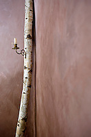 This imaginative use of a birch tree trunk in the salon has transformed it into a candlestick