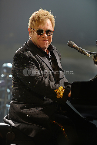 ESTERO FL - MARCH 09: Elton John performs on the Wonderful Crazy Night Tour at The Germain Arena on March 9, 2016 in Estero, Florida. Credit: mpi04/MediaPunch