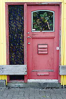 Red door and yellow building, Granville Island, Vancouver, BC, Canada