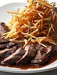 Hanger Steak with fried shoestring potatoes.