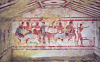 "Underground Etruscan tomb Known as ""Tomba Claudio Bettini no 5513"" A single chamber with double sloping ceiling. In the tympanium on the back wall is a painted two lions, a two men lying on beds (Klinai) are  banquetting with two women bellow. On the dide walls are dancers and musicians. 5th century BC. Excavated 1967 , Etruscan Necropolis of Monterozzi, Monte del Calvario, Tarquinia, Italy. A UNESCO World Heritage Site."