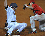 Ole Miss' Jordan King (10) is tagged out by Georgia's Curt Powell (8) in college baseball action at Oxford-University Stadium in Oxford, Miss. on Friday, April 8, 2011. Georgia won 9-8.