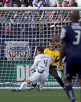 New England Revolution forward Zack Schilawski (15) takes on DC United defender Marc Burch (4) and DC United goalkeeper Pat Onstad (20). In a Major League Soccer (MLS) match, the New England Revolution defeated DC United, 2-1, at Gillette Stadium on March 26, 2011.