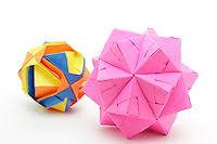 New York, NY, USA - October 27, 2011: Two modular Origami balls folded by Esme Cribb. On the left is an Ishibashi ball designed by Japanese Origami artist Minako Ishibashi. On the right is a polyhedron made up of Sonobe Units designed by Mitsonobu Sonobe. Both designs use multiple squares of paper, each folded and then assembled.
