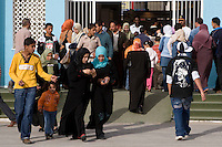 Tripoli, Libya, North Africa - Libyan Men, Women, Families at International Trade Fair.  Clothing Styles.