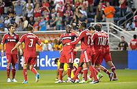 Chicago forward Dominic Oduro (8) gets a high five from his teammates after scoring the Fire's second goal.  The Chicago Fire defeated the Columbus Crew 2-1 at Toyota Park in Bridgeview, IL on June 23, 2012.