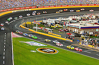 Scene-setter and on-track action photo from the 2012 Coca-Cola 600 NASCAR Sprint Cup race held May 27 (Memorial Day Sunday) at the Charlotte Motor Speedway in Concord, NC. The annual 600-mile (965.606 km) race, first held in 1960, is the longest race sanctioned by NASCAR. Quaker State Chevrolet driver Kasey Kahne, with the Hendrick Motorsports group, won the race, finishing nearly five seconds ahead of Denny Hamlin. It was Kahne's 13th career win.