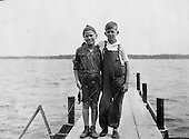 Ann Arbor, MI - FILE --  Gerald Ford (left) and his cousin Gardner James display the day's catch from a fishing dock.  Date: ca. 1923.<br /> Credit: Courtesy Gerald R. Ford Library via CNP