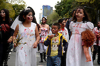 D.F. Mexico, November 23. 2013. Children attend a rally while Thousands of people dressed as zombies take part in a march from the plaza of the three cultures on the Paseo de la Reforma Avenue to the Angel of Independence.  VIEWpress/Miguel Angel Pantaleon